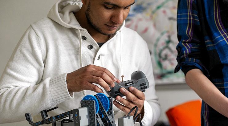 Student building a mechanical robot