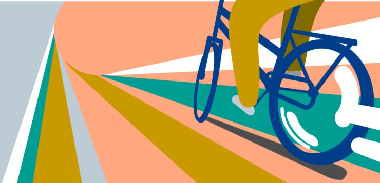 Pyöräilijä pyöräilee baanalla