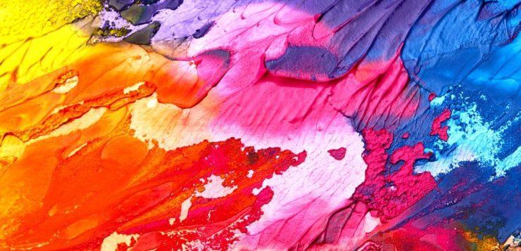 Kuvituskuva. Värikkäitä värejä sekoitettuna toisiinsa.