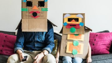 People wearing boxes
