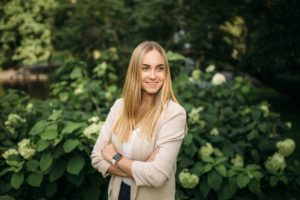 International Business alumna Ekaterina standing in a park