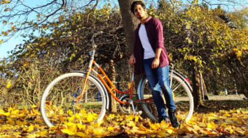 Computer Applications student Siddharth with a bicycle in an autumn surroundings
